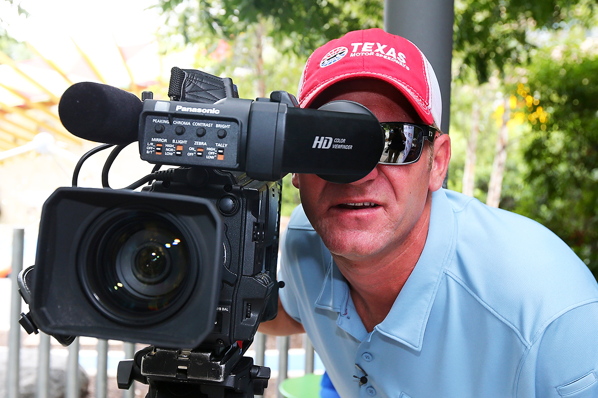 "DALLAS, Texas - SEPTEMBER 15: NASCAR Sprint Cup Series driver Clint Bowyer poses as a pestering videographer to prank Texas Motor Speedway season ticket holders before revealing his identity as part of NASCAR's Chase Across North America Day on September 15, 2015 at Klyde Warren Park in Dallas, Texas City. Three Texas Motor Speedway season ticket holders arrived for a fictitious ""Texas Motor Speedway Fan Appreciation Day"" video shoot but instead got to meet the Chase contender and receive autographed items and gift bag. (Photo by Sarah Crabill/Getty Images for Texas Motor Speedway) *** Local Caption *** Clint Bowyer"