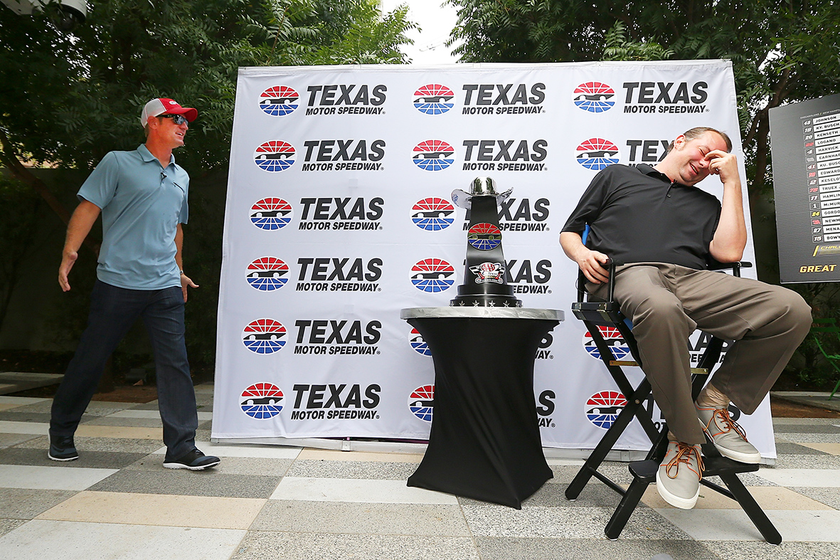 "DALLAS, Texas - SEPTEMBER 15: NASCAR Sprint Cup Series driver Clint Bowyer (L) surprises Texas Motor Speedway season ticketholder Tom Porter during a prank as part of NASCAR's Chase Across North America Day on September 15, 2015 at Klyde Warren Park in Dallas, Texas. Bowyer posed as a pestering videographer for a fictitious ""Texas Motor Speedway Fan Appreciation Day"" before revealing his identity and surprising the season ticketholder. (Photo by Sarah Crabill/Getty Images for Texas Motor Speedway) *** Local Caption *** Clint Bowyer; Tom Porter"