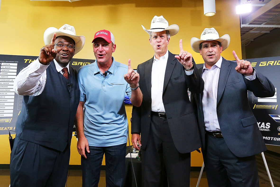FORT WORTH, Texas - SEPTEMBER 15: NASCAR Sprint Cup driver Clint Bowyer (2nd from left) made a visit to the KXAS-NBC 5 newsroom and poses with (L-R) the station's sports director Newy Scruggs, general manager Tom Ehlmann and Telemundo general manager John Trevino as part of NASCAR's Chase Across North America Day on September 15, 2015 in Fort Worth, Texas. (Photo by Sarah Crabill/Getty Images for Texas Motor Speedway) *** Local Caption *** Clint Bowyer