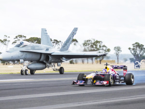 Daniel Ricciardo performs alongside Michael Kneightley in an RAAF F/A-18 Hornet at RAAF Base in East Sale, Victoria, Australia on March 12, 2014.