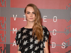 Cara Delevingne in Saint Laurent cropp