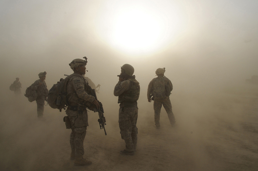 Sgt. 1st Class Lance Amsden, platoon sergeant for the 1st Platoon, Company C, 1st Battalion, 501st Infantry Regiment, 4th Brigade Combat Team (Airborne), 25th Infantry Division, watches as CH-47 Chinook Helicopters circle above during a dust storm at Forward Operating Base Kushamond, Afghanistan, July 17, during preparation for an air-assault mission.