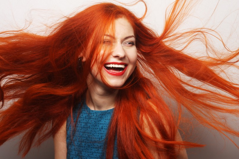 Beautiful-young-happy-woman-with-long-flowing-red-hair-805x537